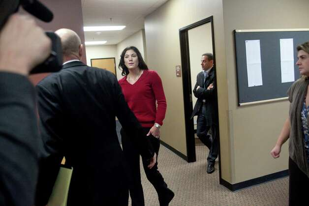 Soccer star Hope Solo leaves a conference room with her lawyer Peter Offenbecher, left, before a bail hearing for former Seattle Seahawks player Jerramy Stevens. Stevens appeared in Kirkland Municipal Court for a domestic violence probable cause hearing. He was released without conditions by the judge who didn't find probable cause to hold him. Photo: JOSHUA TRUJILLO / SEATTLEPI.COM