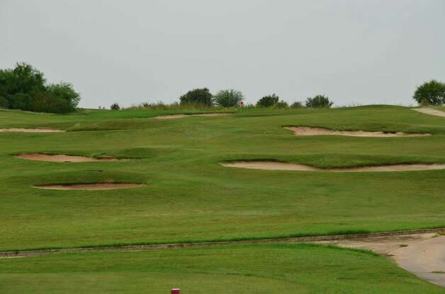 Numerous bunkers are prepared to punish the inaccurate on No. 7 at River Bend Golf Club.