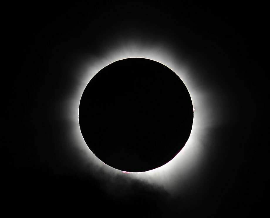 Totality is seen during the solar eclipse at Palm Cove on November 14, 2012 in Palm Cove, Australia. Thousands of eclipse-watchers have gathered in part of North Queensland to enjoy the solar eclipse, the first in Australia in a decade. Photo: Ian Hitchcock, Getty Images
