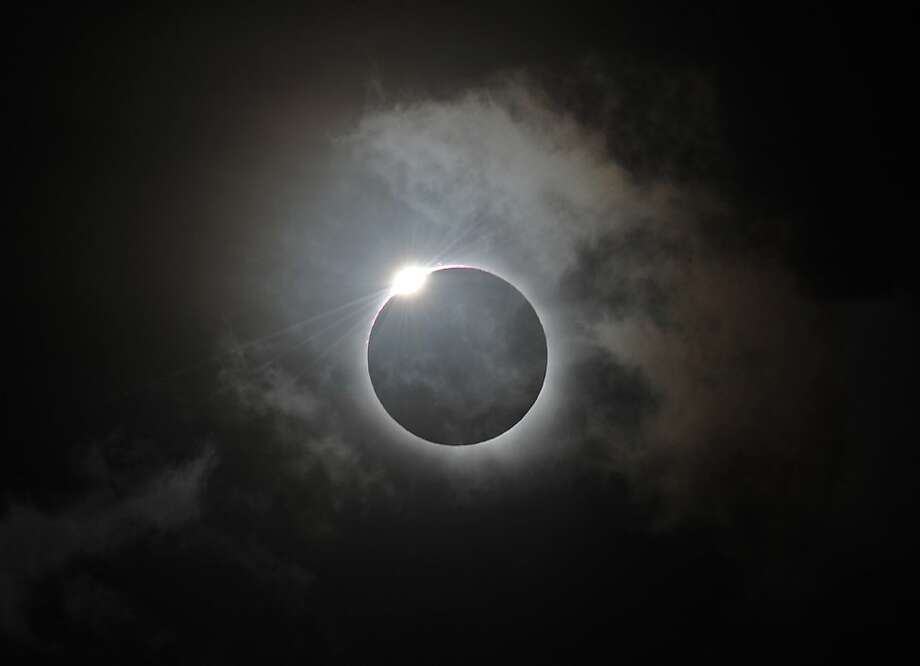 The Diamond Ring effect is shown following totality of the solar eclipse at Palm Cove in Australia's Tropical North Queensland on November 14, 2012. Eclipse-hunters have flocked to Queensland's tropical northeast to watch the region's first total solar eclipse in 1,300 years on November 14, which occurred as the moon passed between the earth and the sun, casting a shadow path on the globe and lasting for a maximum on the Australian mainland of 2 minutes and 5 seconds. Photo: Greg Wood, AFP/Getty Images