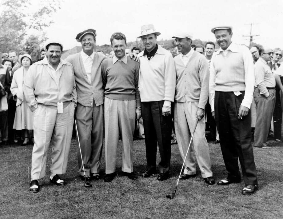 Jackie Burke was a national golf legend and celebrity. Pictured here on a trip to the Catskills in 1954 are comedian Buddy Hackett, left,  golfers Jimmy Demaret, Jackie Burke, Sam Snead, Ben Hogan, and singer Billy Eckstine. / handout