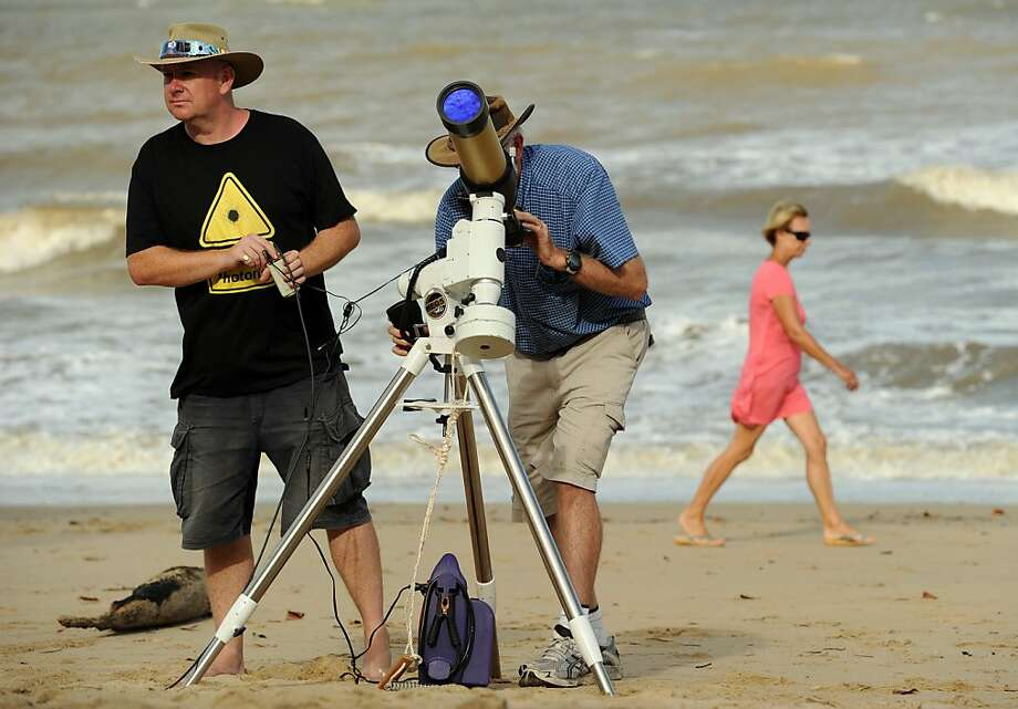 Equipment is made ready to be used for a direct feed of the total solar eclipse to NASA on the foreshore at Palm Cove in Tropical North Queensland on November 13, 2012. Tens of thousands of people were flocking to Australia's laid-back tropical north for a total solar eclipse on November 14, a phenomenon officials say has not been seen in the region in 1,300 years. Photo: Greg Wood, AFP/Getty Images