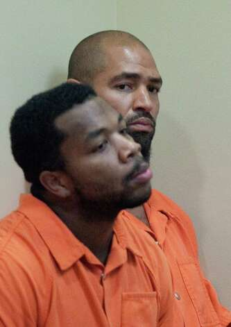 Former Seattle Seahawks player Jerramy Stevens, rear, listens during a bail hearing for Stevens in Kirkland Municipal Court. Stevens appeared in court for a domestic violence probable cause hearing. He was released without conditions by the judge who didn't find probable cause to hold him. Photo: JOSHUA TRUJILLO / SEATTLEPI.COM