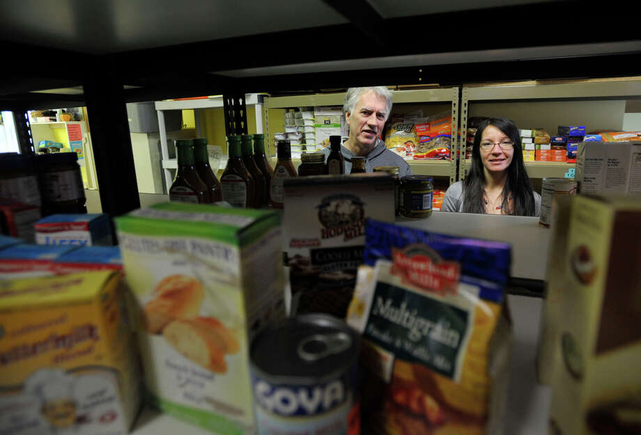 Mike Greene, pantry coordinator, and Gabriela Barkan, nutritionist, stand in the Interfaith AIDS Ministry food pantry in Danbury on Tuesday, Nov. 13, 2012. Photo: Jason Rearick / The News-Times