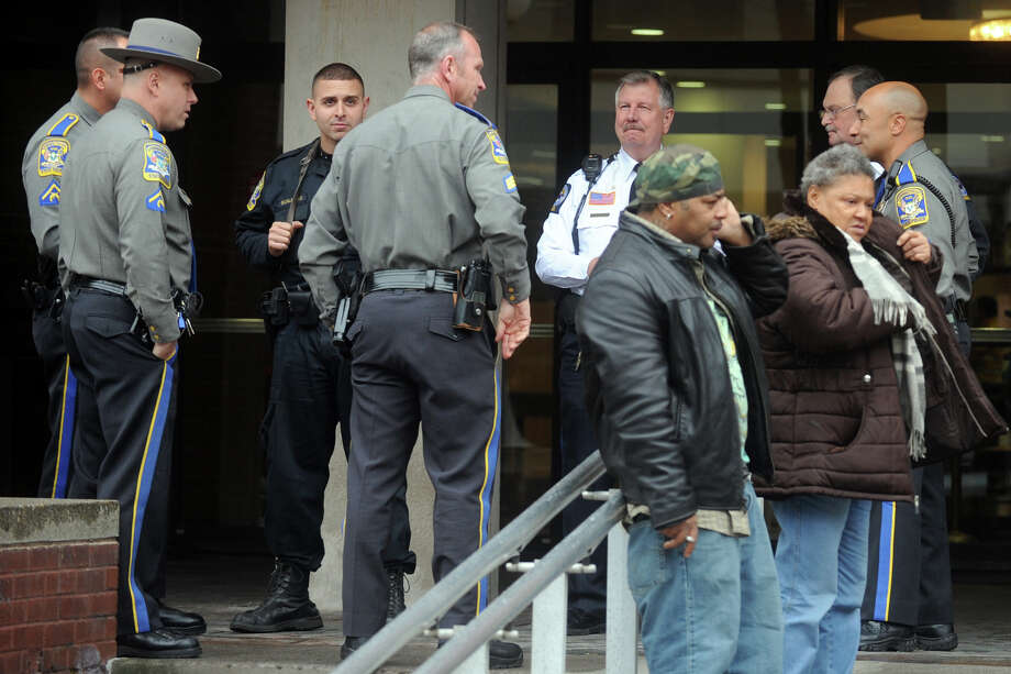 State Police and court security officers stand watch in front of the Main Street courthouse, in Bridgeport, Conn. Nov. 13th, 2012, where five young men charged with killing a city teen in October made an appearance. Photo: Ned Gerard / Connecticut Post