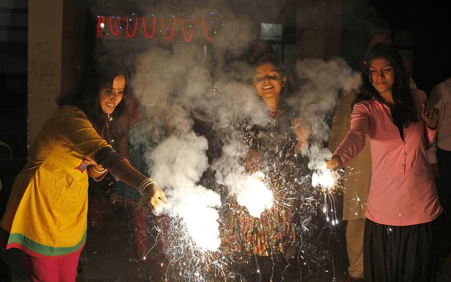 People play with firecrackers during Diwali, the festival of lights, in Allahabad, India, Tuesday, Nov. 13, 2012. Hindus across the country are celebrating Diwali where people decorate their homes with light and burst firecrackers. Photo: Rajesh Kumar Singh, Associated Press