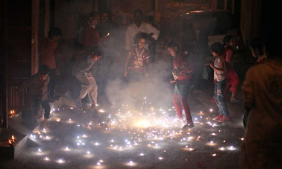 Indian children play with firecrackers during Diwali in New Delhi, India, Tuesday, Nov. 13, 2012. Photo: Altaf Qadri, Associated Press