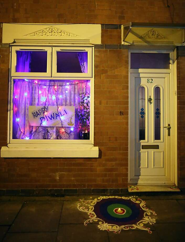 A house is decorated to celebrate the Hindu festival of Diwali on November 13, 2012 in Leicester, United Kingdom. Up to 35,000 people attended the Diwali festival of light in Leicester's Golden Mile in the heart of the city's asian community. The festival is an opportunity for Hindus to honour Lakshmi, the goddess of wealth and other gods. Leicester's celebrations are one of the biggest in the world outside India. Sikhs and Jains also celebrate Diwali. Photo: Christopher Furlong, Getty Images