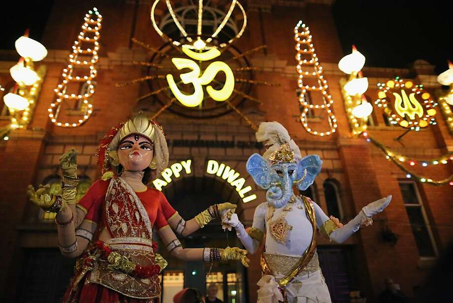 People dressed as the gods, Lord Ganesha and Goddess Lakshmi, walk through the streets during the Hindu festival of Diwali on November 13, 2012 in Leicester, United Kingdom. Up to 35,000 people attended the Diwali festival of light in Leicester's Golden Mile in the heart of the city's asian community. The festival is an opportunity for Hindus to honour Lakshmi, the goddess of wealth and is one of the biggest in the world outside India. Sikhs and Jains also celebrate Diwali. Photo: Christopher Furlong, Getty Images