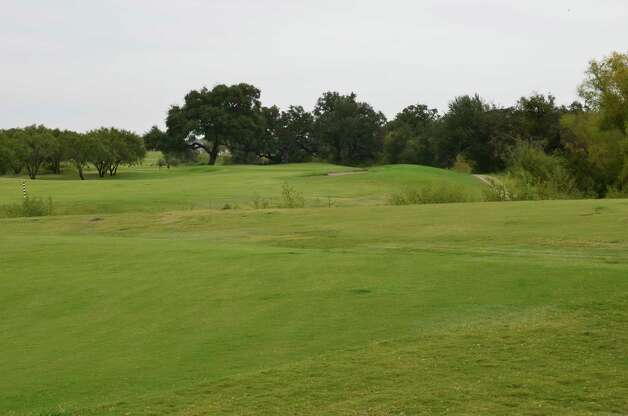 A mostly dry creek cuts through the No. 12 fairway at River Bend Golf Club. Photo: LeAnna Kosub, Express-News
