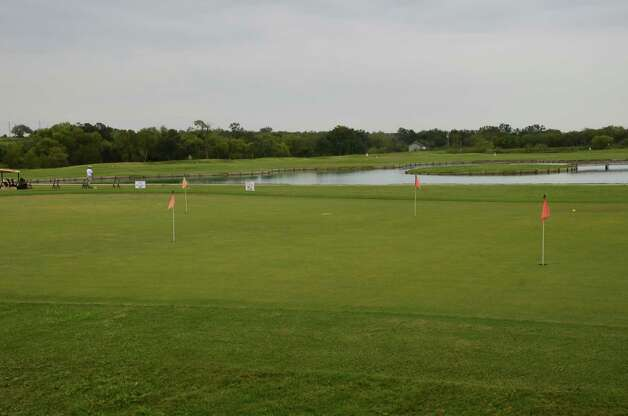 The River Bend Golf Club practice area includes a putting green, driving range and a target island for precision practice. Photo: LeAnna Kosub, Express-News