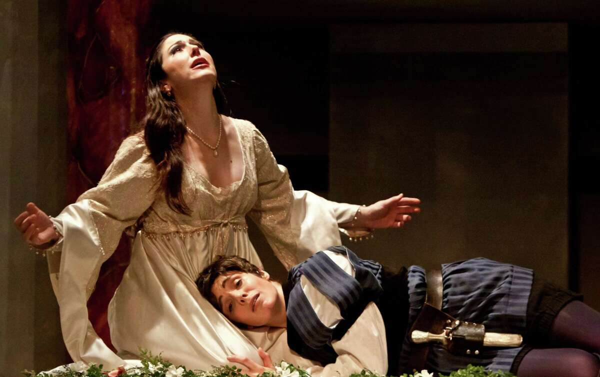 """Camille Zamora, left, and Sarah Heltzel star as Juliet and Romeo in Opera in the Heights' production of """"I Capuleti e i Montecchi"""" (The Capulets and the Montagues)."""