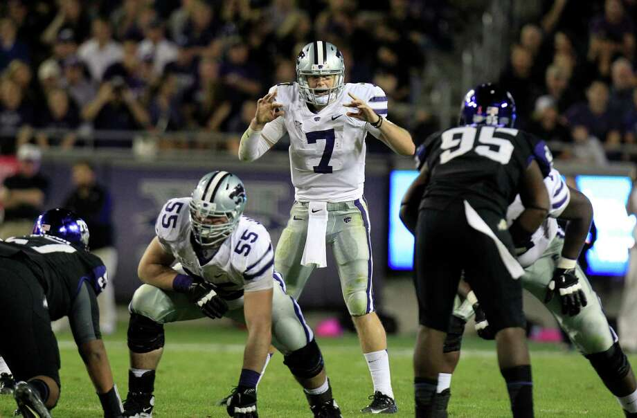 Kansas State quarterback Collin Klein (7) lines up for the snap during the NCAA college football game against TCU Saturday, Nov. 10, 2012, in Fort Worth, Texas. (AP Photo/LM Otero) Photo: LM Otero, Associated Press / AP