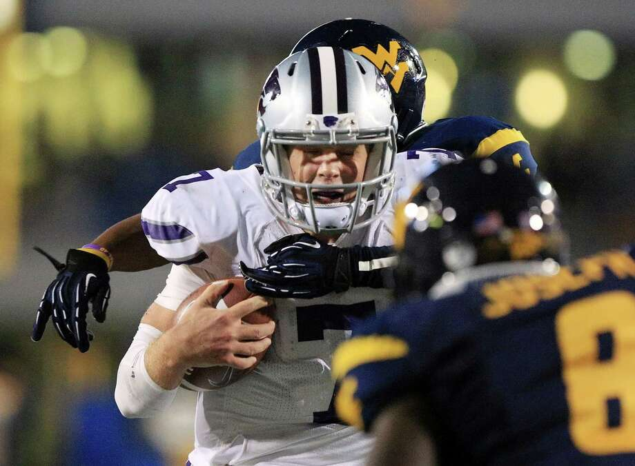 Kansas State quarterback Collin Klein (7) is brought down near the goal line by West Virginia's Pat Miller, rear, and Karl Joseph (8) during the second quarter of an NCAA college football game in Morgantown, W.Va., Saturday, Oct. 20, 2012. Kansas State won 55-14. (AP Photo/Christopher Jackson) Photo: Christopher Jackson, Associated Press / FRE170573 AP