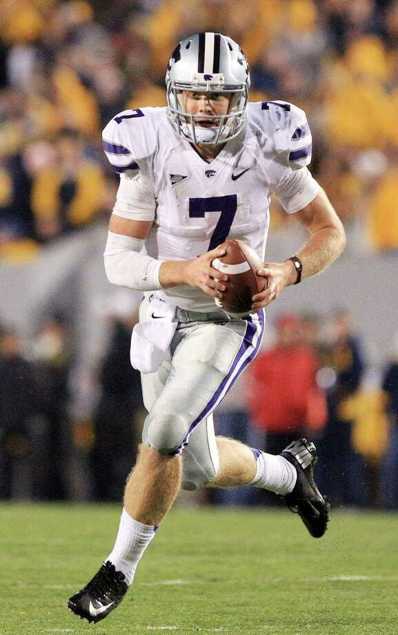Kansas State quarterback Collin Klein (7) rolls out of the pocket during an NCAA college football game against West Virginia in Morgantown, W.Va., Saturday, Oct. 20, 2012. Kansas State won 55-14. (AP Photo/Christopher Jackson) Photo: Christopher Jackson, Associated Press / FRE170573 AP
