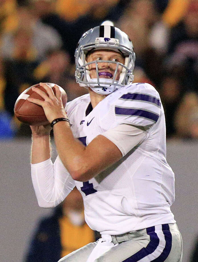 Kansas State quarterback Collin Klein looks to pass during an NCAA college football game against West Virginia in Morgantown, W.Va., Saturday, Oct. 20, 2012. Kansas State won 55-14. (AP Photo/Christopher Jackson) Photo: Christopher Jackson, Associated Press / FRE170573 AP