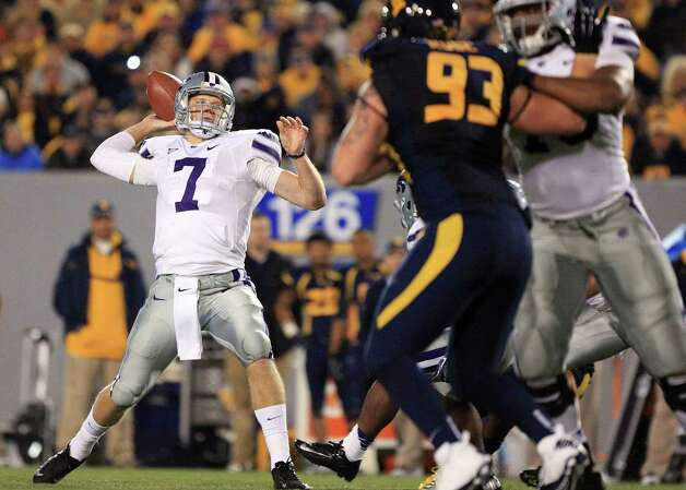 Kansas State quarterback Collin Klein (7) prepares to pass during an NCAA college football game against West Virginia in Morgantown, W.Va., Saturday, Oct. 20, 2012. Kansas State won 55-14. (AP Photo/Christopher Jackson) Photo: Christopher Jackson, Associated Press / FRE170573 AP