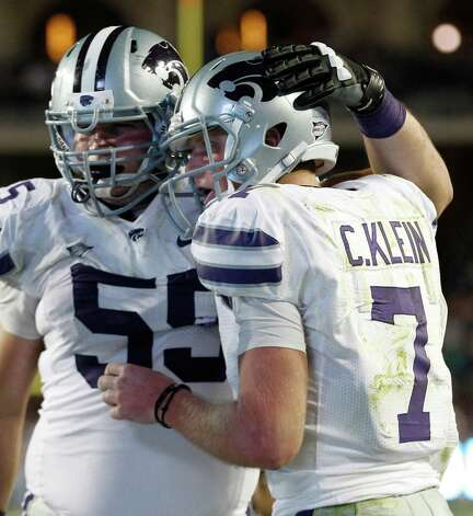 Kansas State quarterback Collin Klein (7) gets a hug from teammate offensive linesman Cody Whitehair (55) after Klein scored a touchdown against TCU during the third quarter of an NCAA college football game, Saturday, Nov. 10, 2012, in Fort Worth, Texas. (AP Photo/LM Otero) Photo: LM Otero, Associated Press / AP