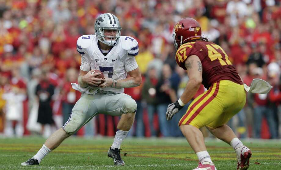 Kansas State quarterback Collin Klein, left, runs past Iowa State linebacker A.J. Klein during the second half of an NCAA college football game, Saturday, Oct. 13, 2012, in Ames, Iowa. Kansas State won 27-21. (AP Photo/Charlie Neibergall) Photo: Charlie Neibergall, Associated Press / AP