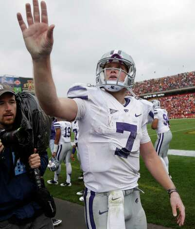 Kansas State quarterback Collin Klein waves to fans after an NCAA college football game against Iowa State, Saturday, Oct. 13, 2012, in Ames, Iowa. Kansas State won 27-21. (AP Photo/Charlie Neibergall) Photo: Charlie Neibergall, Associated Press / AP