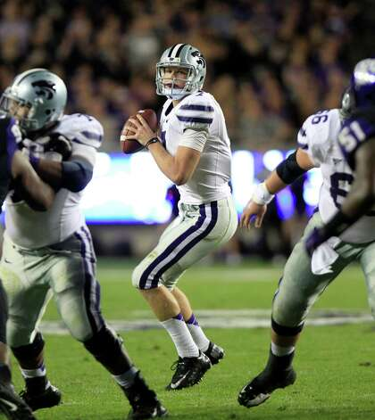 Kansas State quarterback Collin Klein (7) looks to pass during the second half of the NCAA college football game against TCU Saturday, Nov. 10, 2012, in Fort Worth, Texas.  Klein ran for two touchdowns and No. 3 Kansas State bolstered its national title hopes with a 23-10 victory at Big 12 newcomer TCU. (AP Photo/LM Otero) Photo: LM Otero, Associated Press / AP