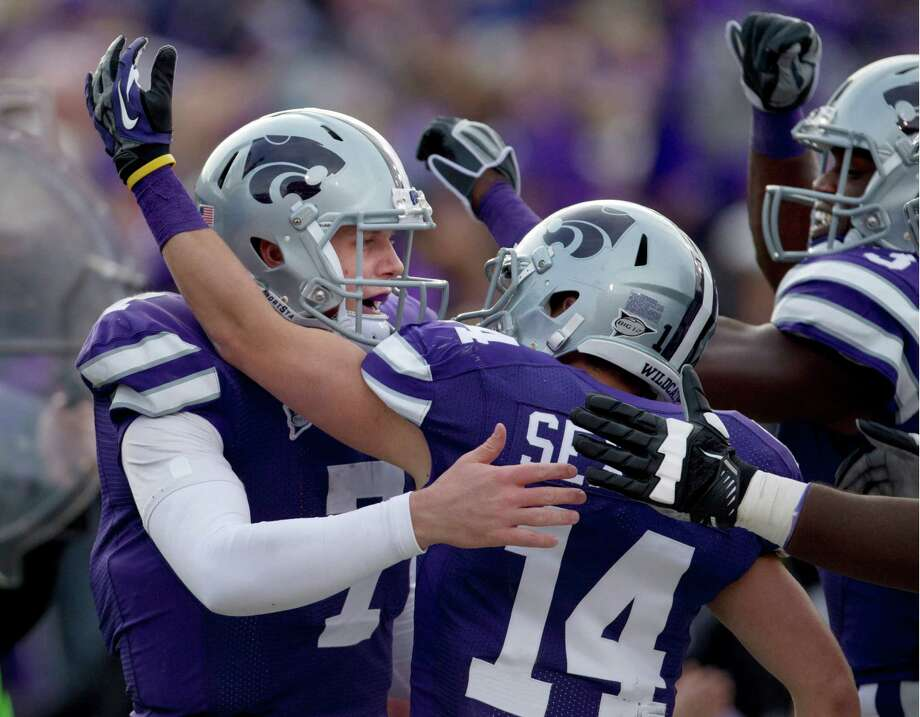 Kansas State quarterback Collin Klein (7) celebrates a touchdown with teammates Curry Sexton (14) and Tyson Williams, right, during the second half of an NCAA college football game against Texas Tech in Manhattan, Kan., Saturday, Oct. 27, 2012. (AP Photo/Orlin Wagner) Photo: Orlin Wagner, Associated Press / AP