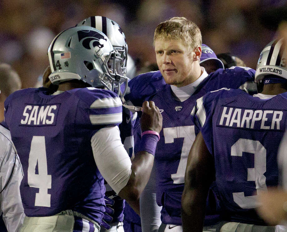 Kansas State quarterback Collin Klein (7) talks to quarterback Daniel Sams (4) during the second half against Oklahoma State in Manhattan, Kan., Nov. 3, 2012. Sams replaced Klein in the fourth quarter. Kansas State defeated Oklahoma State 44-30. (AP Photo/Orlin Wagner) Photo: Orlin Wagner, Associated Press / AP
