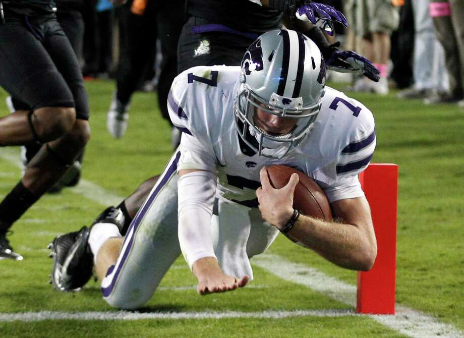 Kansas State quarterback Collin Klein (7) scores a touchdown against TCU during the third quarter of an NCAA college football game, Saturday, Nov. 10, 2012, in Fort Worth, Texas. (AP Photo/LM Otero) Photo: LM Otero, Associated Press / AP