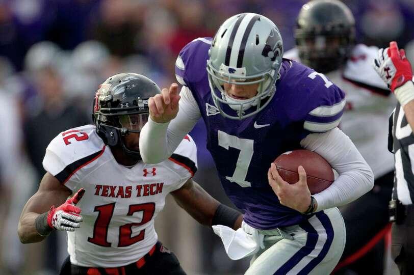 Kansas State quarterback Collin Klein (7) breaks past Texas Tech safety D.J. Johnson (12) for a touc