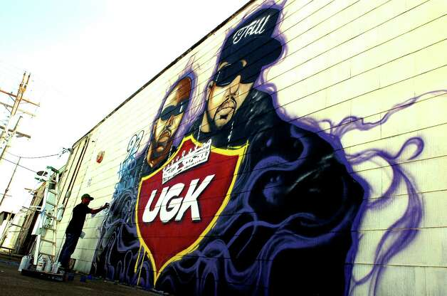 A mural depicting rappers Bun B (left) and Pimp C is painted on the side of a west Port Arthur building by Dez Woods. Photo by Guiseppe Barranco Photo: Guiseppe Barranco