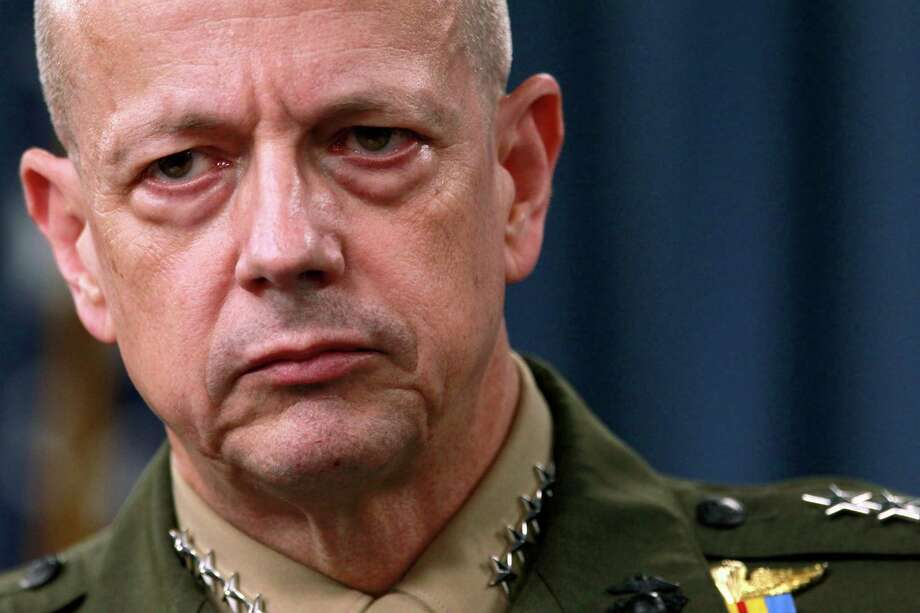 """FILE- In this March 26, 2012, file photo, Marine Gen. John Allen, the top U.S. commander in Afghanistan listens during a news conference at the Pentagon in Washington. The sex scandal that led to CIA Director David Petraeus' downfall widened Tuesday with word the top U.S. commander in Afghanistan is under investigation for thousands of alleged """"inappropriate communications"""" with another woman involved in the case.  (AP Photo/Haraz N. Ghanbari, File) Photo: Haraz N. Ghanbari, STF / AP"""