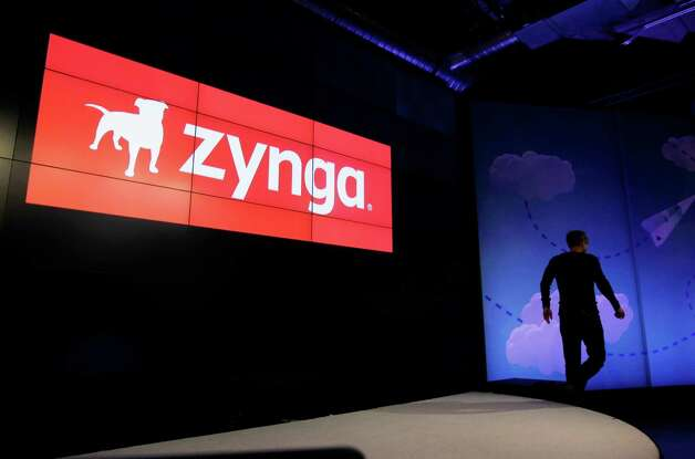 Zynga CEO Mark Pincus walks off the stage after announcing new games in June. His company has struggled to find ways to make money from users. Photo: Paul Sakuma, Associated Press
