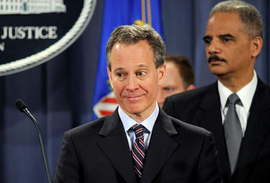 New York Attorney General Eric Schneiderman, accompanied by Attorney General Eric Holder, speaks at the Justice Department in Washington, Friday,Jan. 27, 2012,  after Holder announced the formation of the Residential Mortgage-Backed Securities Working Group. (AP Photo/Cliff Owen) Photo: Cliff Owen, FRE / FR170079 AP