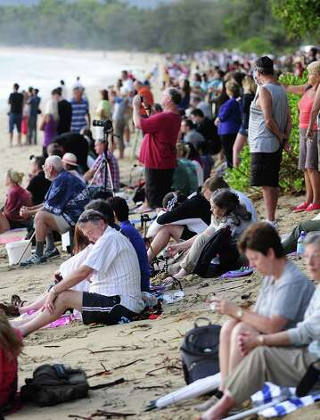 Spectators line the beach to view the total solar eclipse on November 14, 2012 in Palm Cove, Australia. Thousands of eclipse-watchers have gathered in part of North Queensland to enjoy the solar eclipse, the first in Australia in a decade. Photo: Ian Hitchcock, Getty Images / 2012 Getty Images