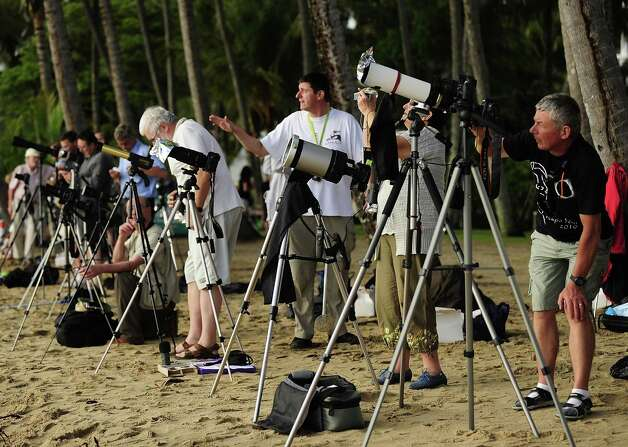 A variety of cameras and telescopes are seen to view the total solar eclipse on November 14, 2012 in Palm Cove, Australia. Thousands of eclipse-watchers have gathered in part of North Queensland to enjoy the solar eclipse, the first in Australia in a decade. Photo: Ian Hitchcock, Getty Images / 2012 Getty Images