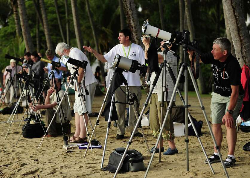 A variety of cameras and telescopes are seen to view the total solar eclipse on November 14, 2012 in