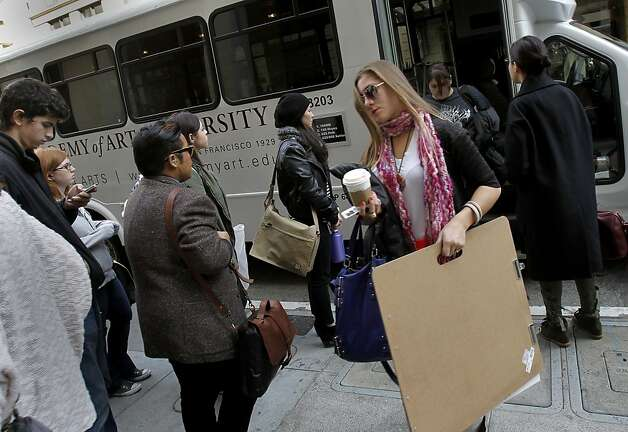 Students file off a shuttle to enter the campus at 180 New Montgomery Street. San Francisco City Attorney Dennis Herrera is questioning the conversion of buildings purchased by the Academy of Art University in San Francisco into student housing and classrooms. Photo: Brant Ward, The Chronicle