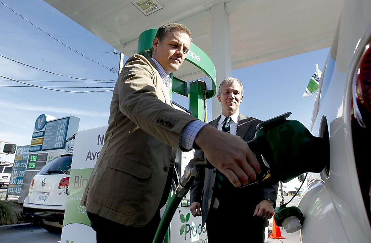 Matt Horton, CEO of Propel Fuels, (left) and Vice President, fuels commercialization, Solazyme, Inc., Bob Ames, through a joint effort fill one of the first vehicles as they began selling biodiesel fuels on Tuesday Nov. 13, 2012 at a Valero station in Redwood City, Calif., one of the four locations in the Bay Area. Bay Area drivers will become the first consumers worldwide to fill their gas tanks with American-made green biodiesel fuels.