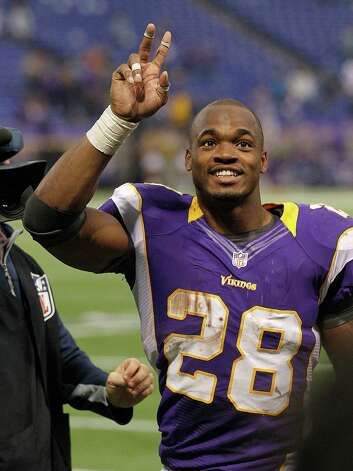 Adrian Peterson (28) of the Minnesota Vikings waves to the crowd after a game with the Detroit Lions on Nov. 11, 2012 at the Hubert H. Humphrey Metrodome in Minneapolis, Minnesota. The Vikings defeated the Lions 34-24. Photo: Andy Clayton King, Getty Images / 2012 Getty Images