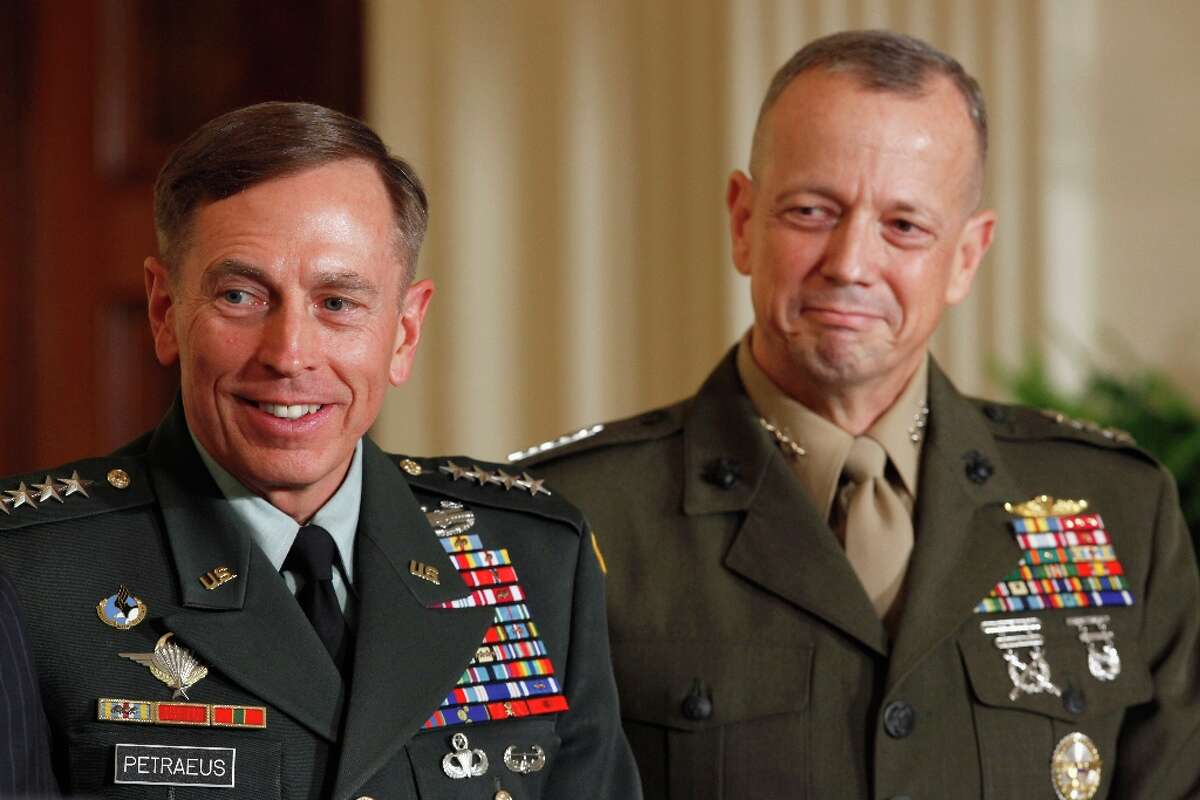 FILE - NOVEMBER 13:: According to reports November 13, 2012, ISAF Commander Gen. John Allen is under investigation after allegedly sending inappropriate emails to a woman linked with the scandal which resulted in the recent resignation of CIA head General David Petraeus WASHINGTON, DC - APRIL 28: U.S. Army Gen. David Petraeus (L) and Marine Corps Gen. John Allen.