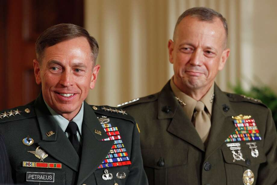 FILE - NOVEMBER 13:: According to reports November 13, 2012, ISAF Commander Gen. John Allen is under investigation after allegedly sending inappropriate emails to a woman linked with the scandal which resulted in the recent resignation of CIA head General David Petraeus WASHINGTON, DC - APRIL 28:  U.S. Army Gen. David Petraeus (L) and Marine Corps Gen. John Allen. Photo: Chip Somodevilla, Getty Images / 2011 Getty Images