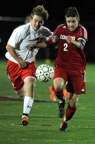 Fairfield Prep's Darragh Kelly and Conard's Colin Wilkinson chase down the ball during overtime in the Class LL soccer quarterfinals Tuesday, Nov. 13, 2012 at Alumni Field on the campus of Fairfield University. Photo: Autumn Driscoll / Connecticut Post