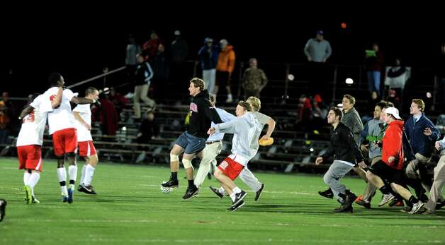 Fairfield Prep fans rush the field to celebrate the team's win over Conard in the Class LL soccer quarterfinals Tuesday, Nov. 13, 2012 at Alumni Field on the campus of Fairfield University. Photo: Autumn Driscoll / Connecticut Post