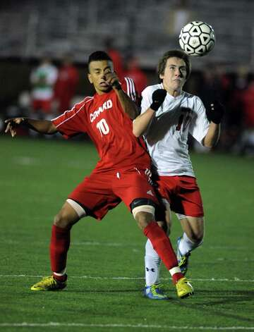 Fairfield Prep's David Bruton looks to head the ball as Conard's Matheus Souza defends during the Class LL soccer quarterfinals Tuesday, Nov. 13, 2012 at Alumni Field on the campus of Fairfield University. Photo: Autumn Driscoll / Connecticut Post