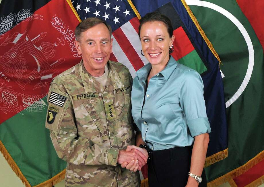 This July 13, 2011 handout image provide by International Security Assistance Force NATO, shows the ISAF Commander Ge, David Petraeus shaking hands with his biographer Paula Broadwell in Afghanistan.  The plot surrounding the resignation of CIA chief David Petraeus over an extramarital affair thickened November 11, 2012 with reports that his alleged lover had sent emails to a second woman seen as a threat to her love interest. Photo: HO, AFP/Getty Images / AFP
