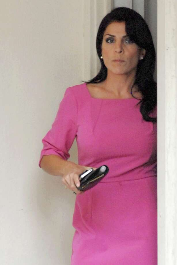 Jill Kelley leaves her home on November 13, 2012 in Tampa, Florida. Kelley, who is reported to be involved with the military community at MacDill Air Force Base, reported receiving harassing emails to the FBI, which resulted in an investigation that revealed the sender to be Paula Broadwell, who was found to be having an affair with Gen. David H. Petraeus. Photo: Tim Boyles, Getty Images / 2012 Getty Images