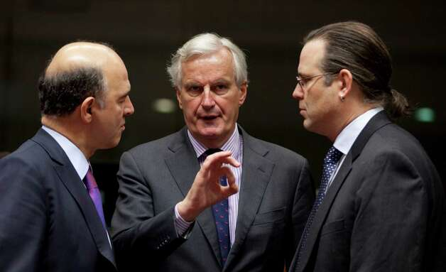 European Commissioner for Internal Market Michel Barnier, center, speaks with French Finance Minister Pierre Moscovici, left, and Sweden's Finance Minister Anders Borg during a meeting of EU finance ministers at the EU Council building in Brussels on Tuesday, Nov. 13, 2012. Shoring up Europe's banking sector and strengthening oversight of economic policies will likely top the agenda of a meeting Tuesday of the European Union's 27 finance ministers. (AP Photo/Virginia Mayo) Photo: Virginia Mayo