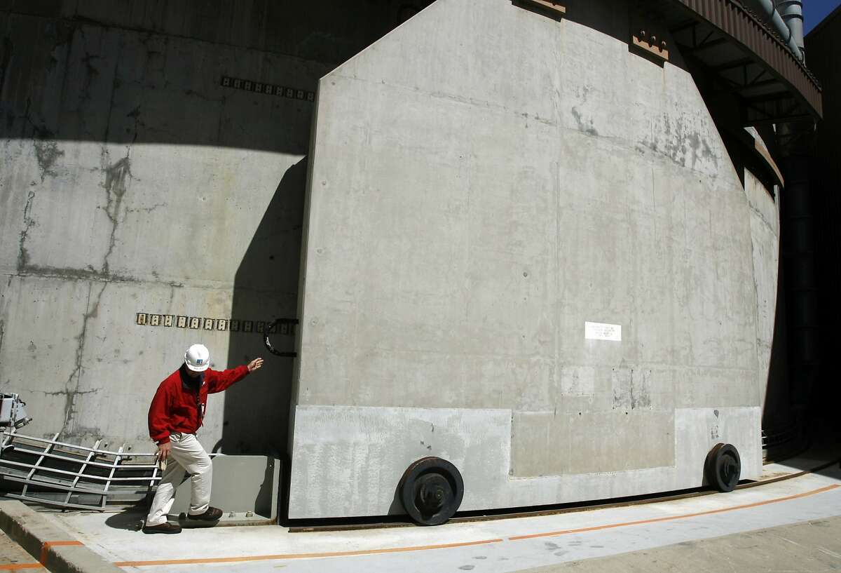 Radiation protection manager Bob Hite checks a heavily-fortified concrete door which leads to one of the nuclear reactors at PG&E's Diablo Canyon nuclear power plant in Avila Beach, Calif. on Friday, May 26, 2006. PAUL CHINN/The Chronicle **Bob Hite