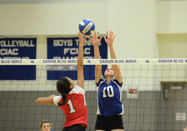 Darien's Taylor Cockerill (10) blocks a shot by Greenwich's Jenny Cespedes (1) during the girls volleyball match at Darien High School on Tuesday, Nov. 13, 2012. Photo: Amy Mortensen / Connecticut Post Freelance