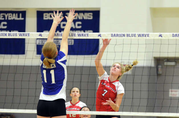 Greenwich's Jenny Cespedes Liza Johnson (7) hits the ball over the net as Darien's Claire Naughton (11) defends during the girls volleyball match at Darien High School on Tuesday, Nov. 13, 2012. Photo: Amy Mortensen / Connecticut Post Freelance